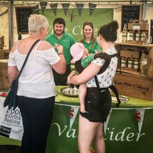 Customers being served at a Vale Cider stall