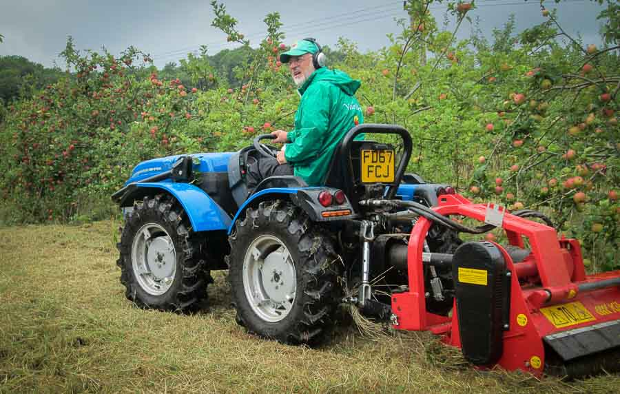 Mowing in a Vale Cider orchard