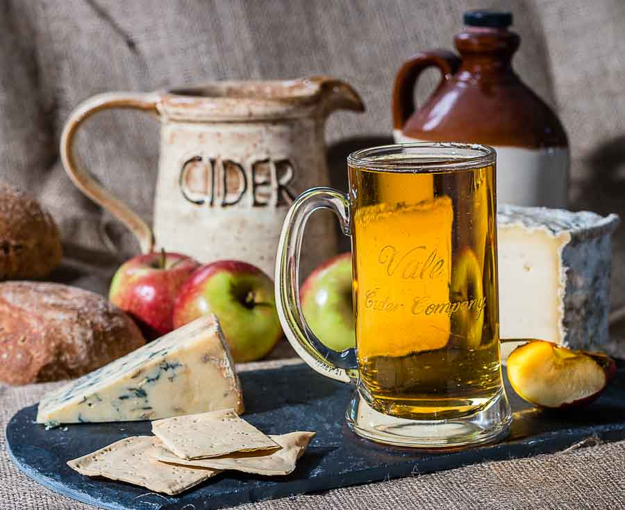 tankard of Vale Cider with jug and cheese platter