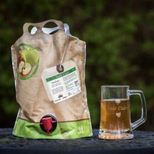 3 litre pouch of Vale Cider with a tankard outdoors