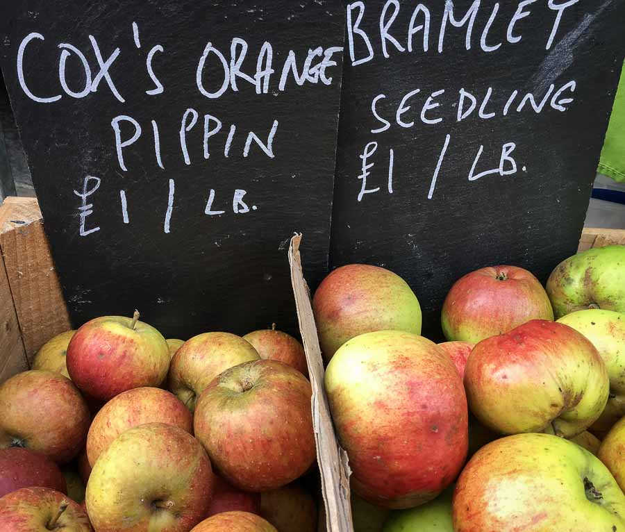 Boxes of apples on sale on market stall
