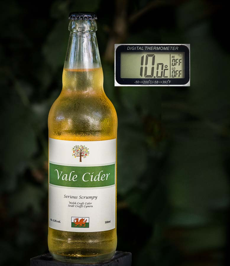 Bottle of cider with thermometer showing 10C