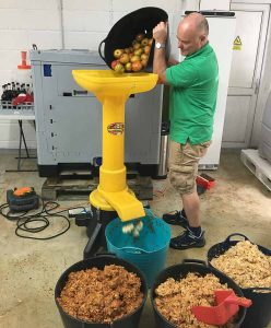 Pouring Apples into Scratter at Vale Cider
