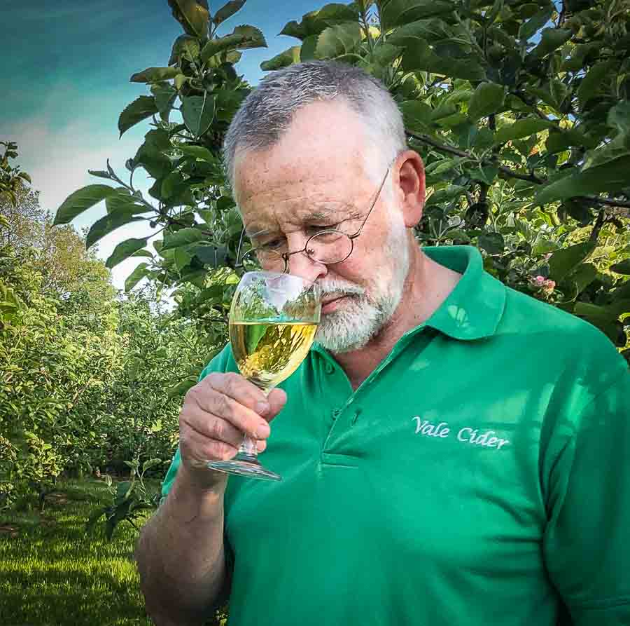Man sniffing glass of cider