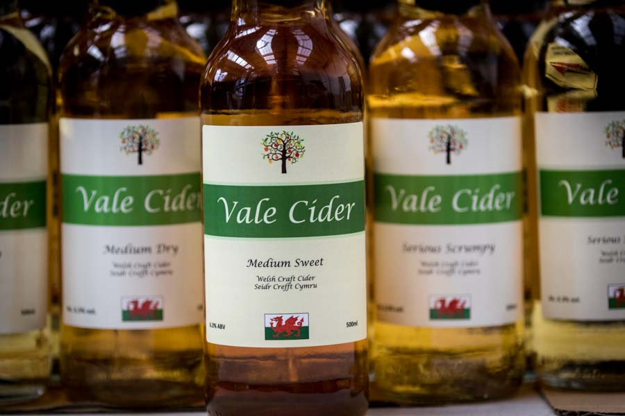 Medium Sweet Vale Cider bottle in row of bottles