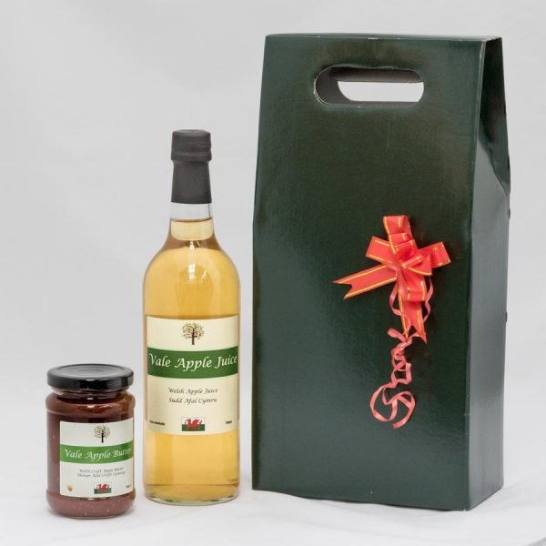 Gift box with bottle of apple juice and jar of apple butter