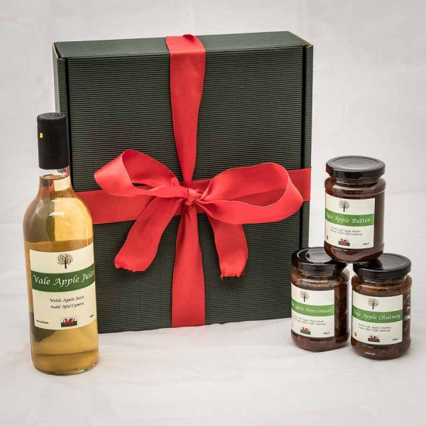 Gift box with apple juice bottle and 3 jars of apple food products