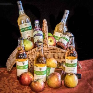 basket of apples with Vale Cider products
