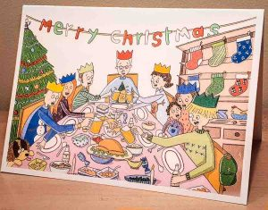 Christmas card with family around dinner table