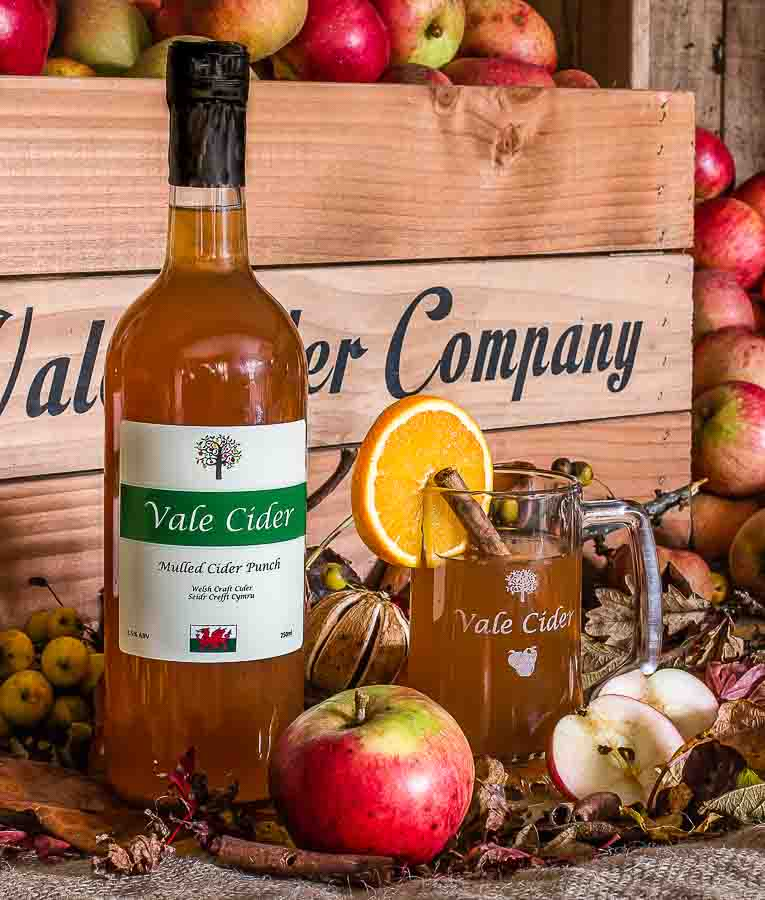 Mulled cider with apples and autumn display