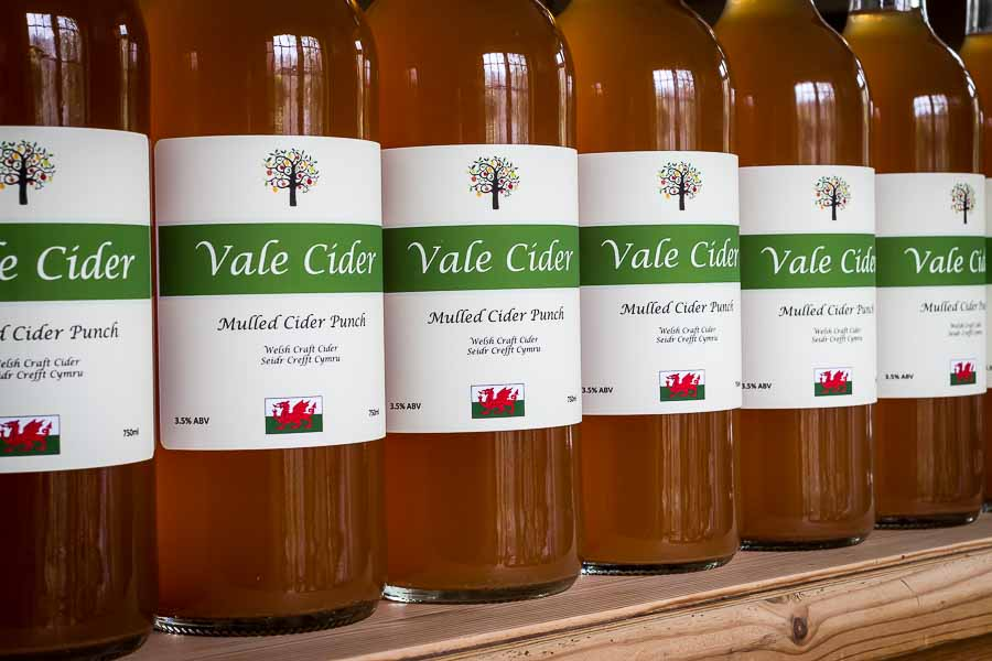 Row of bottles of mulled cider